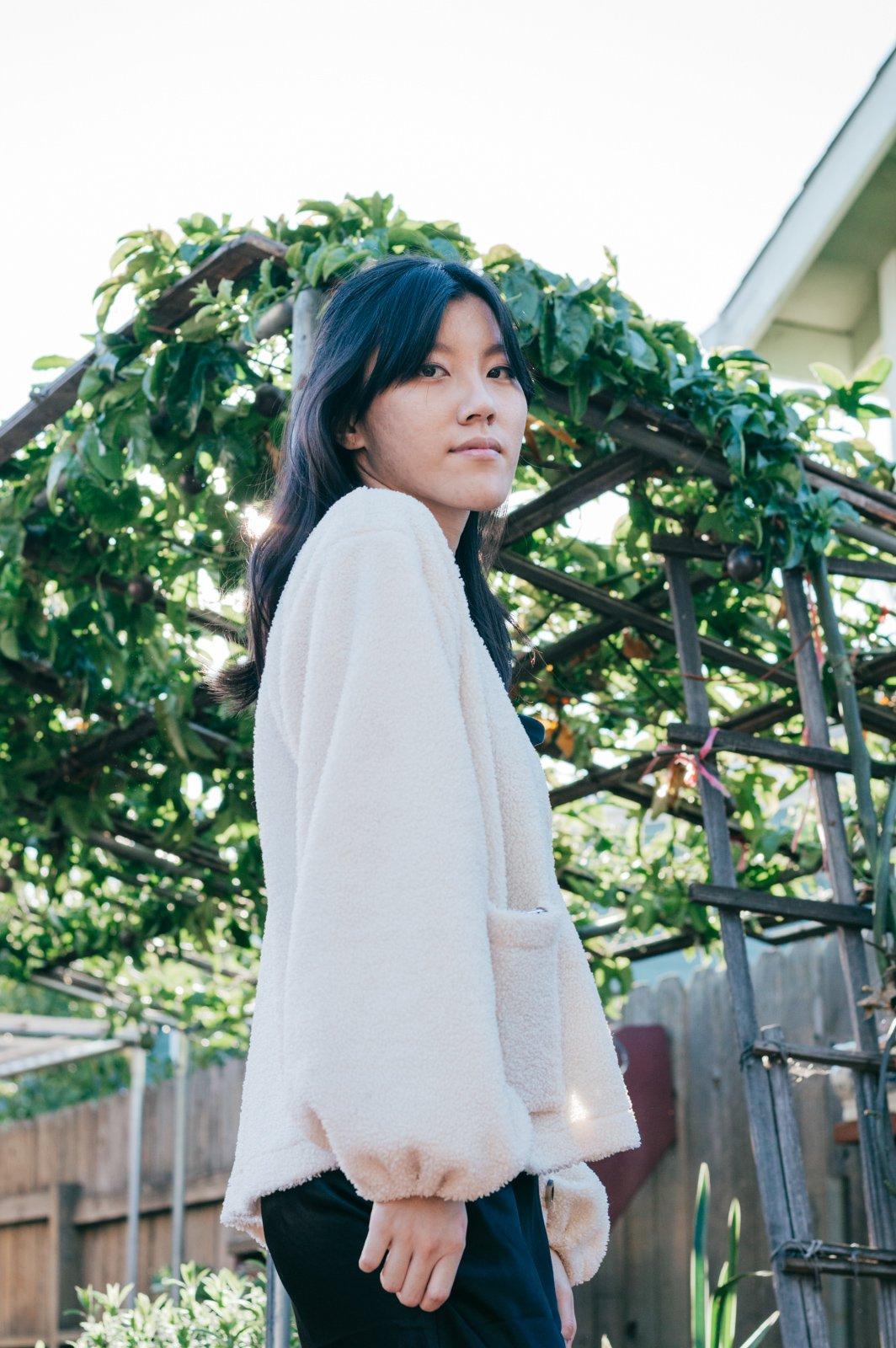 Girl wearing white cardigan